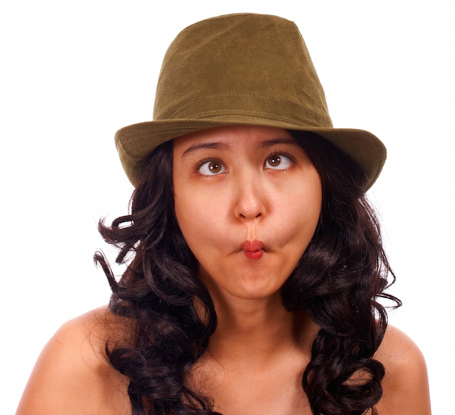 Girl Wearing A Hat And Looking Crazy With Cross Eyes
